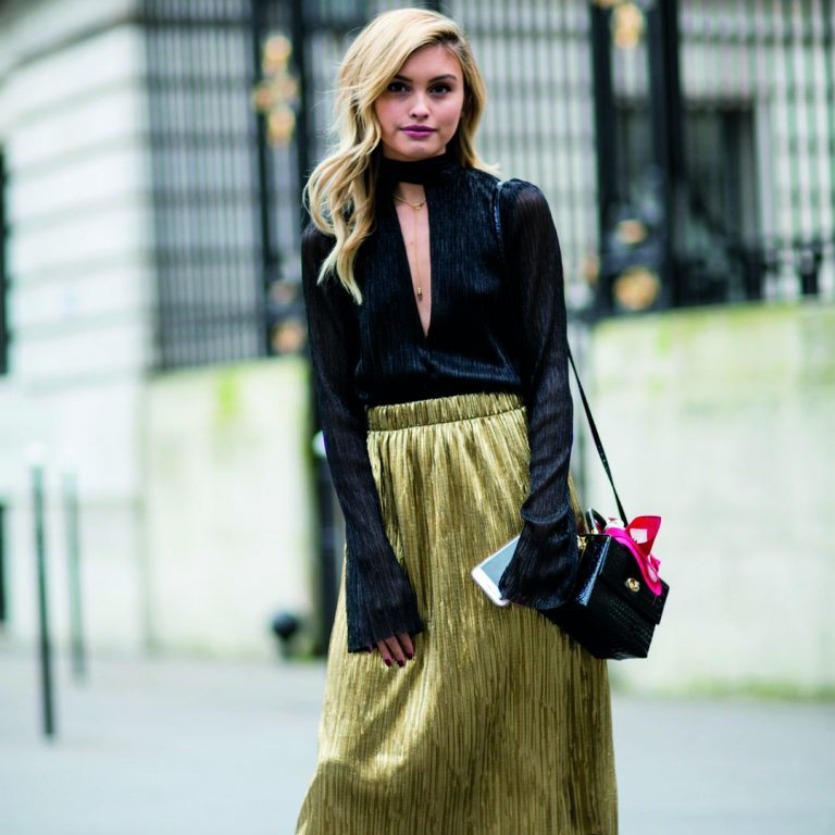 How should you wear a pleated skirt for the holidays?