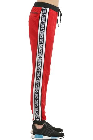 ANDREA CREWS NEW MAN LOGO SIDE BANDS TRACK PANTS