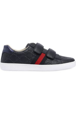 Gucci Logo Embossed Leather Strap Sneakers