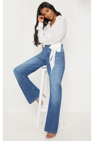 PRETTYLITTLETHING Petite Mid Wash Extreme Wide Leg Jean