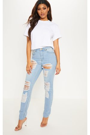 PRETTYLITTLETHING Tall Mid Wash Extreme Distressed Mom Jeans
