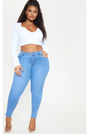 PRETTYLITTLETHING Plus Light Wash Skinny Jeans