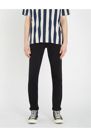 J Brand Tyler slim-fit tapered stretch jeans