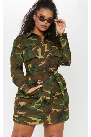 PRETTYLITTLETHING Plus Camo Utility Tie Waist Shirt Dress