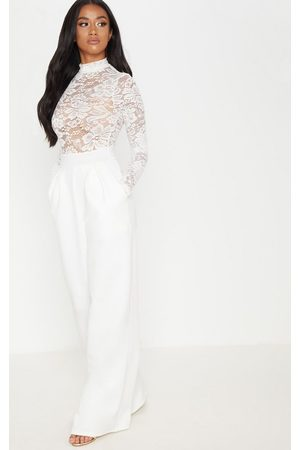 PRETTYLITTLETHING Petite Lace High Neck Long Sleeve Jumpsuit