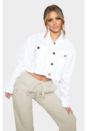 PRETTYLITTLETHING Petite Raw Hem Cropped Denim Jacket
