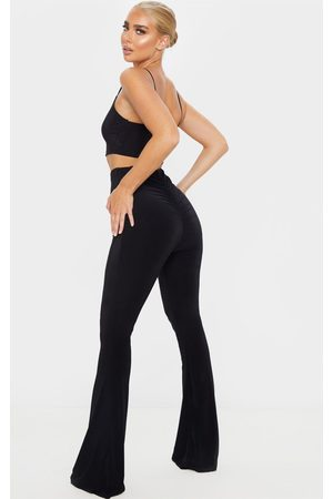 PRETTYLITTLETHING Flare Ruched Bum Slinky Pants