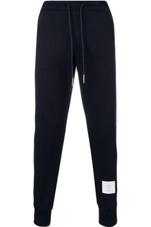 Thom Browne Men Sweatpants - RWB stripe loopback track pants
