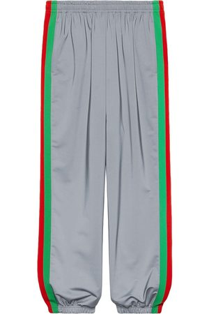 Gucci Reflective side stride track pants