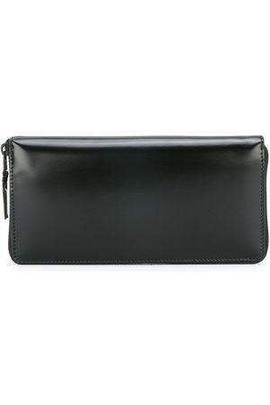 Comme des Garçons Wallets - Zip around wallet