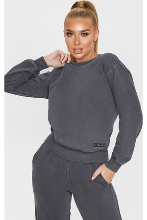 PRETTYLITTLETHING Charcoal Badge Detail Sport Sweater
