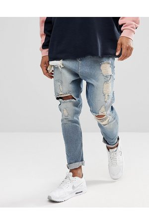 ASOS Drop crotch jeans in vintage light wash with heavy rips