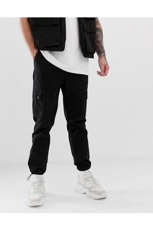 ASOS Tapered cargo pants in with toggles
