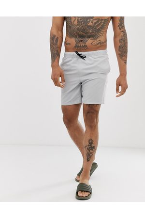 ASOS Swim shorts in light in mid length