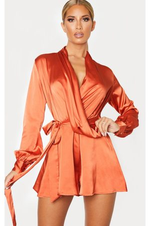 PRETTYLITTLETHING Women Playsuits - Rust Satin Drape Detail Long Sleeve Romper