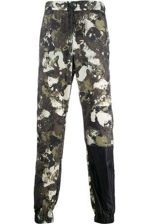MARCELO BURLON Men Sweatpants - Camouflage-print drawstring trousers