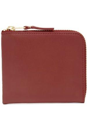 Comme des Garçons Zip-around Leather Wallet - Womens
