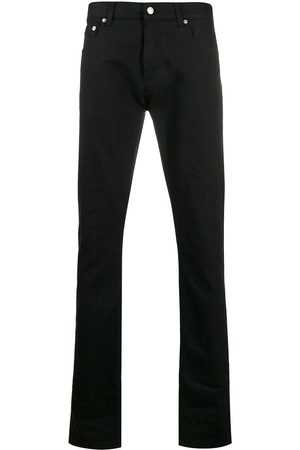 Alexander McQueen Dragon patch tapered jeans