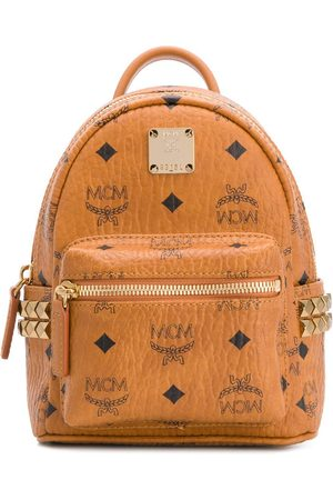 MCM Baby Stark studded monogram backpack