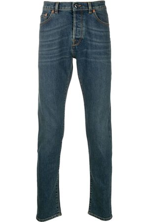 VALENTINO Rockstud-embellished slim-fit jeans