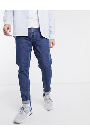 Weekday Cone slim tapered jeans in