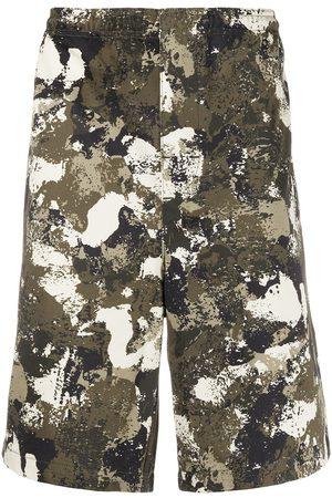 MARCELO BURLON Men Bermudas - Camouflage print bermudas