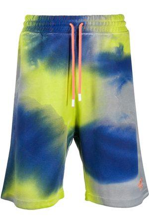 MARCELO BURLON Tie-dye logo track shorts