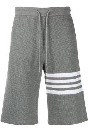 Thom Browne Men Bermudas - 4-Bar waffle stitch track shorts - Grey