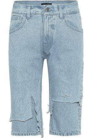 RAF SIMONS Distressed mid-rise denim shorts