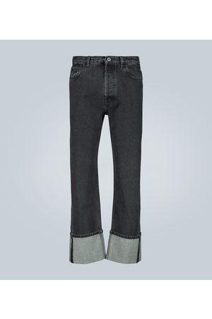 VALENTINO Logo-print wide-leg jeans
