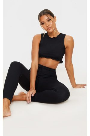 PRETTYLITTLETHING Ribbed Legging And Frill Edge Crop PJ Set