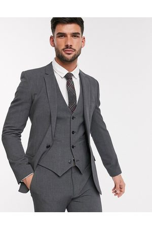ASOS Suits - Super skinny suit jacket in four way stretch in charcoal