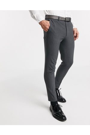 ASOS Skinny Pants - Super skinny suit pants in four way stretch in charcoal