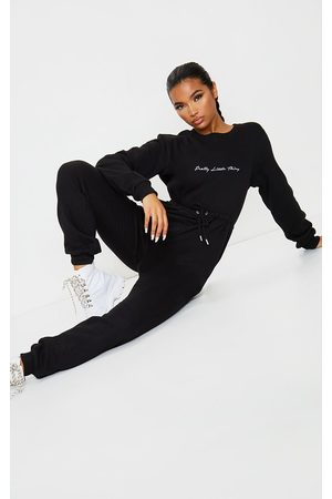 PRETTYLITTLETHING Women Jumpsuits - Embroidered Sweat Jumpsuit