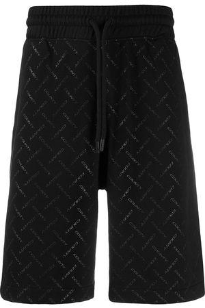 MARCELO BURLON Multi logo print track shorts