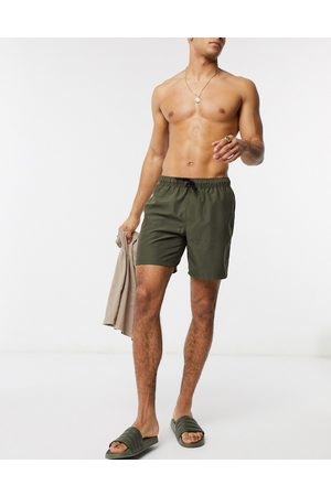 ASOS Swim shorts in khaki mid length
