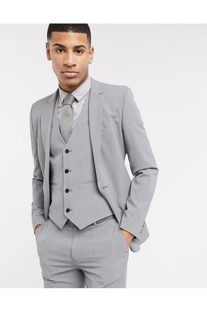 ASOS Suits - Super skinny suit jacket in four way stretch in mid