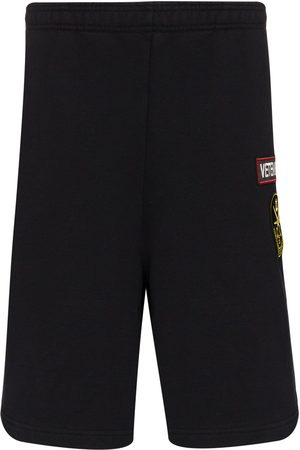 Vetements Logo-embroidered track shorts