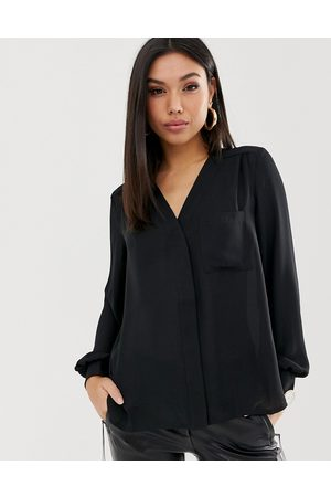 ASOS Long sleeve blouse with pocket detail in
