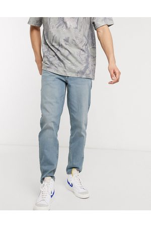 ASOS Stretch tapered jeans in light wash
