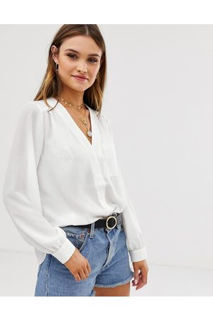 ASOS Long sleeve blouse with pocket detail in Ivory