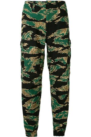 A BATHING APE® Camouflage print trousers