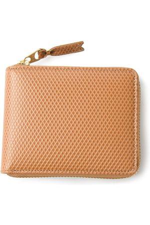 Comme des Garçons Textured zip around wallet - Neutrals