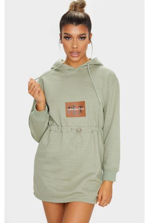 PRETTYLITTLETHING Sage Toggle Front Hoodie Sweater Dress