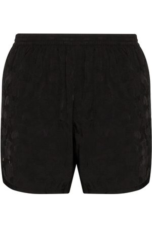 TRUE TRIBE Men Swim Shorts - Wild Steve camouflage print swim shorts