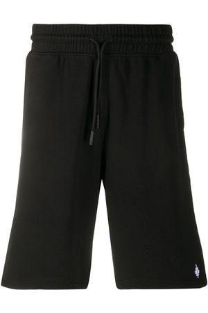 MARCELO BURLON Graphic embroidered shorts