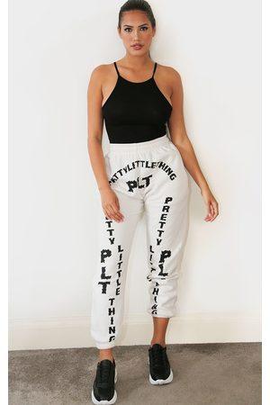 PRETTYLITTLETHING Shape Cream Slogan Print Joggers