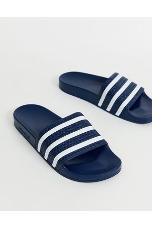 adidas Adilette slides in navy