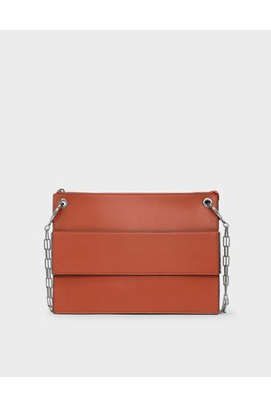 CHARLES & KEITH Grommet Flat Clutch