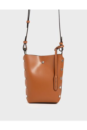 CHARLES & KEITH Mini Reversible Studded Crossbody Bag